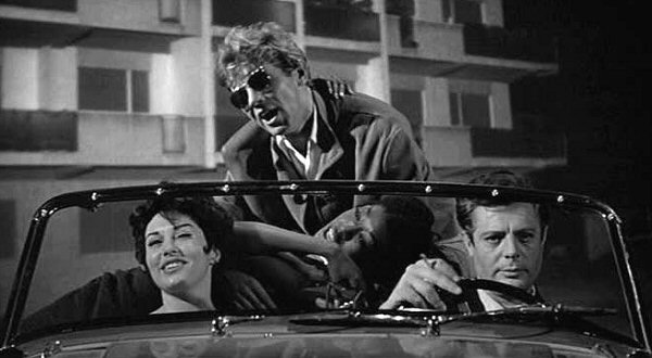 Walter Santesso (center) as Paparazzo in La Dolce Vita